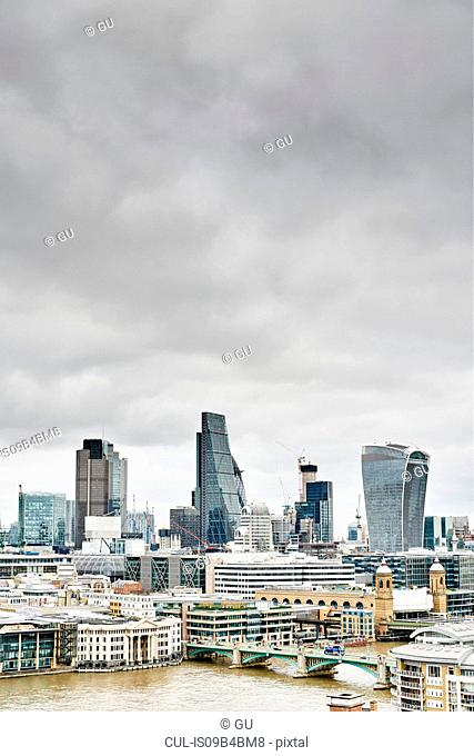City skyline with Walkie Talkie building and river Thames, London, UK