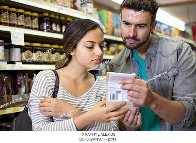 Couple examining product in health food store
