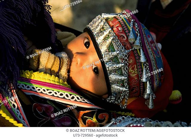 A cute Hani girl dressed in a traditional dress, China