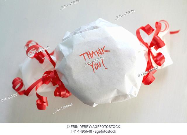 A wrapped gift with the words 'Thank You' on it