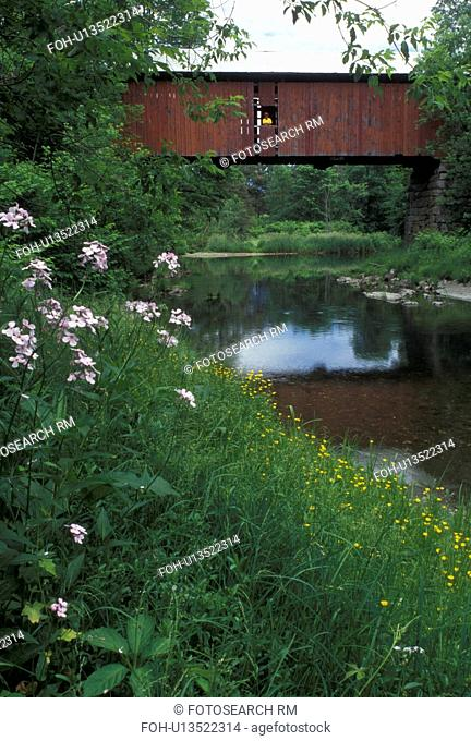 covered bridge, river, spring, Northfield Falls, VT, Vermont, Woman stands in window of Slaughter House Covered Bridge which crosses over Dog River in the...
