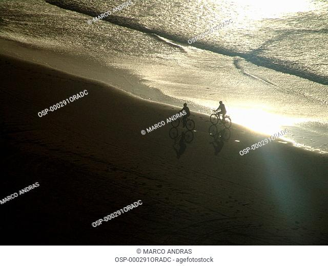 people riding bikes at ceara beach shore