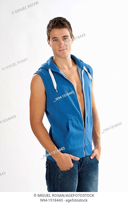 Half-length photograph of a teenage boy, with blue jeans and sleeveless vest
