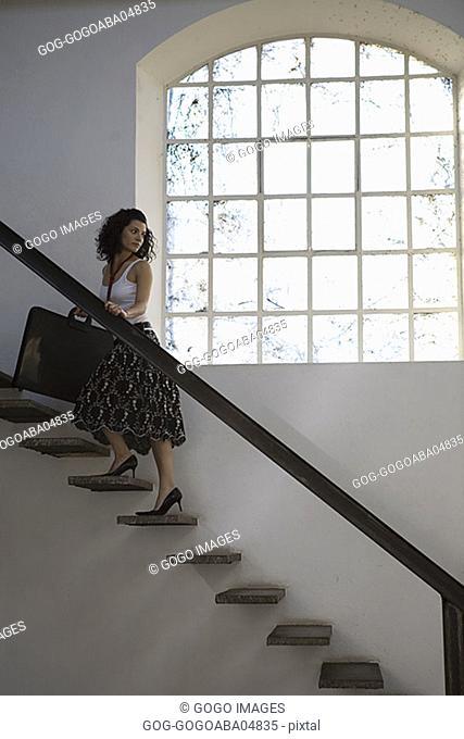 Woman climbing a staircase