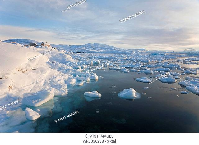 Winter landscape with ice sheets floating on the ocean surface