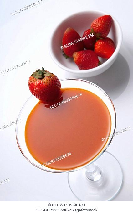 High angle view of a glass of strawberry cocktail