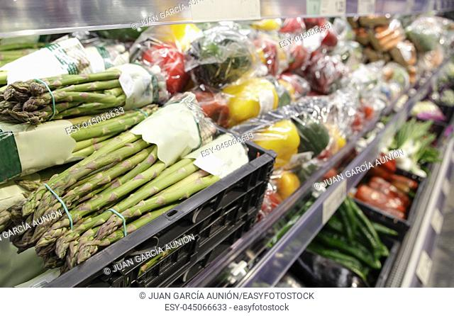 Green asparagus displayed on supermaket. Organic vegetables area