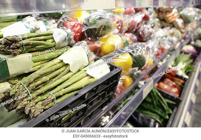 Green asparagus displayed on supermaket. Organic vegetables area
