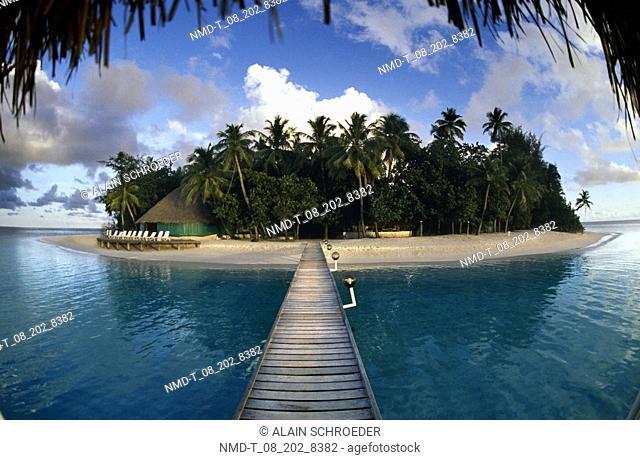 Pier leading to an island, Ihuru Island, Maldives