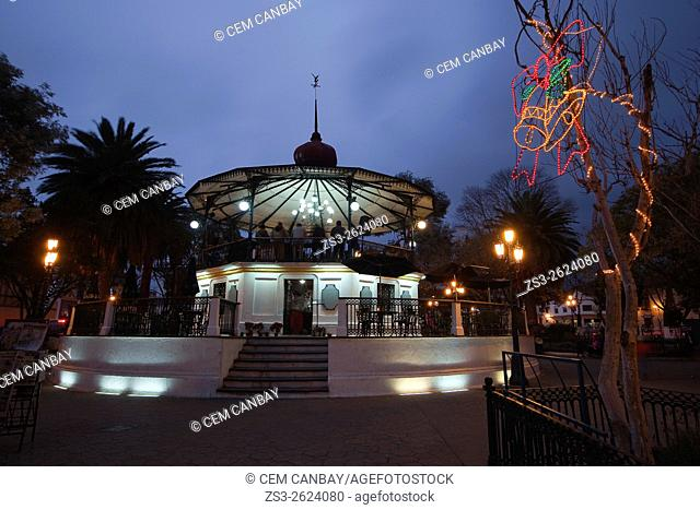 View to the pavilion in the central park-Parque Vicente Espinoza at the Plaza de Marzo by night, San Cristobal de las Casas, Chiapas State, Mexico