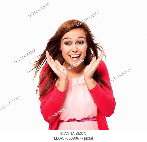 Young surprised woman with hand next to her face, Debica, Poland