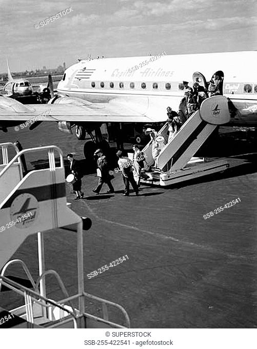 USA, New York City, LaGuardia Airport, Passengers alighting from plane