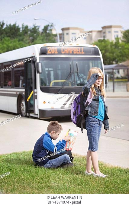 st. albert, alberta, canada, two children waiting for the city bus