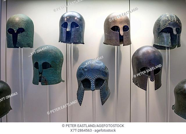 Early classical, Corinthian style, Bronze helmets in the Archaeological museum, Ancient Olympia, Peloponnese, Greece