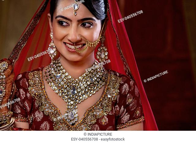 Close-up of a smiling bride looking away
