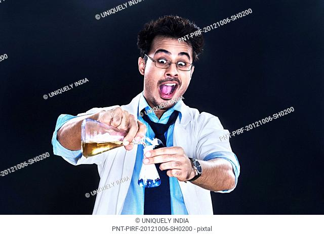 Male scientist experimenting in a laboratory looking surprised