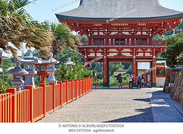 Three senior japanese woman at the entrance of Udo-Jingu shinto temple. The shrine is dedicated to Yamasachihiko, the father of Jimmu