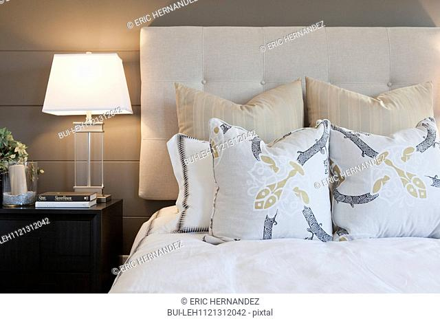 Pillows arrange on bed in contemporary bedroom; Murrieta; California; USA