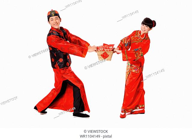 Young couple holding gifts