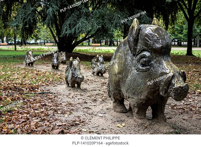 Sculpture group by Alex Garcia of bronze wild boars in the city park Roger Salengro at Nevers, Burgundy, France