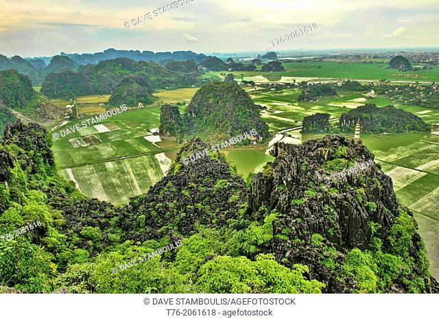 Vietnam. Beautiful limestone karst mountains in Ninh Binh. Image taken from the top of Hang Mua Temple which overlooks the Tam Coc river area as well as all the...