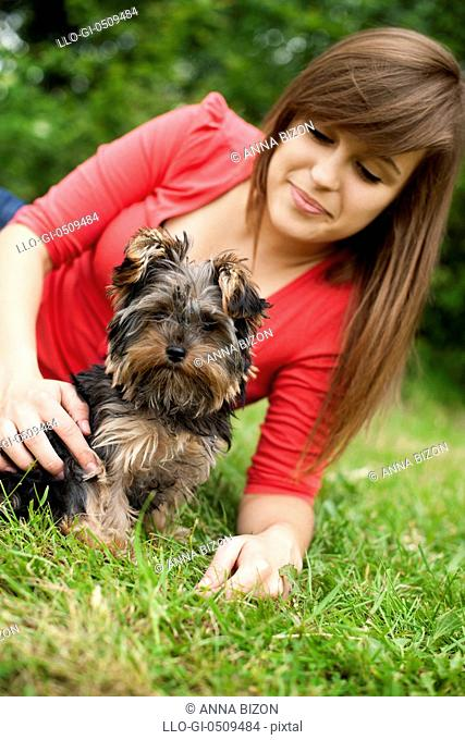 Yorkshire terrier puppy with young woman Debica, Poland