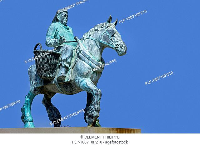 Cloned Paardenvisser, bronze sculpture of shrimper on horseback on the beach at Oostduinkerke, West Flanders, Belgium