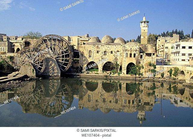 The Great Mosque of al-Nuri and a waterwheel on the Orontes River, Hama, Syria