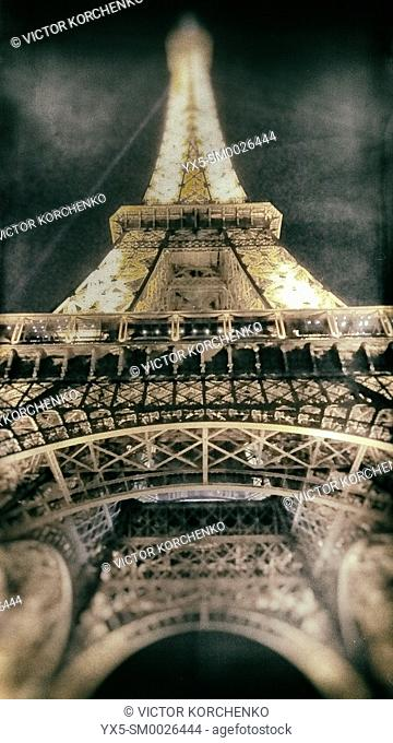 Low angle image of Eiffel Tower illuminated at night