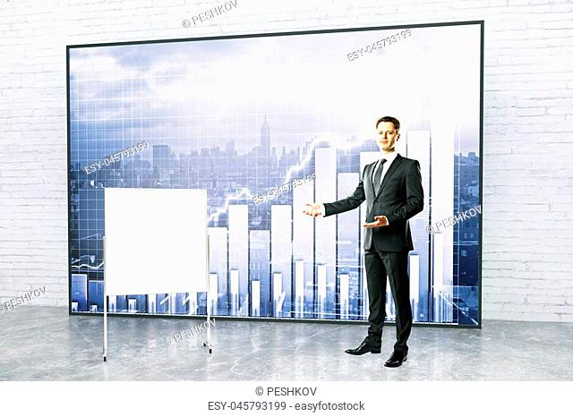 Handsome young businessman giving presentation with blank flipboard and forex chart on city background. Mock up