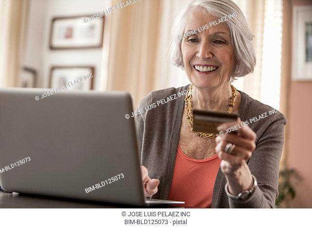 Senior Caucasian woman shopping online