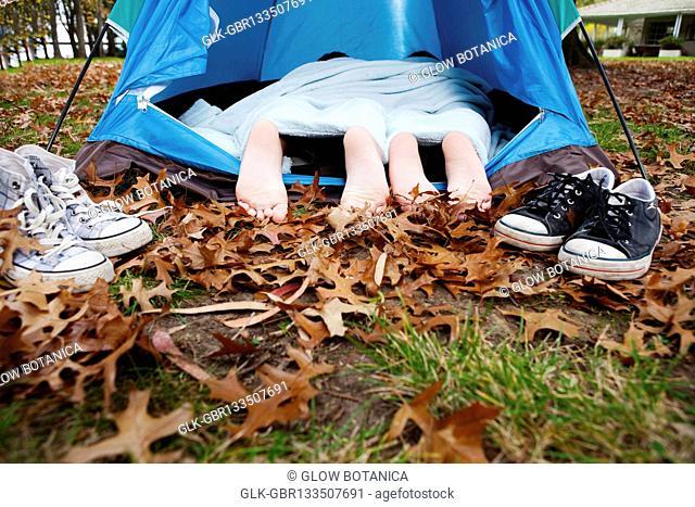 Child's feet under a tent