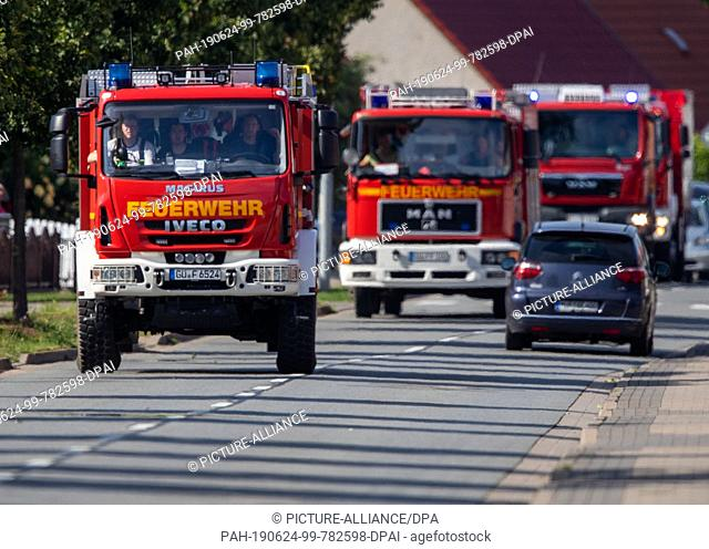 24 June 2019, Mecklenburg-Western Pomerania, Zecheriner Hütte: Fire brigades drive to the crash sites of one of the two Eurofighters