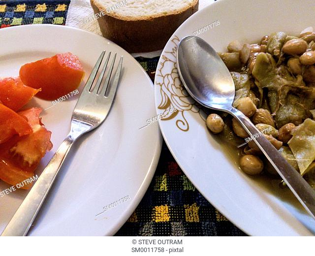 Simple Greek Cuisine. Fresh Tomatoes with Village Bread, Green and Gigandes Beans together