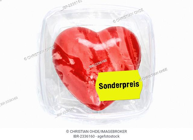 Heart in food storage container with special price label, symbolic image organ trade