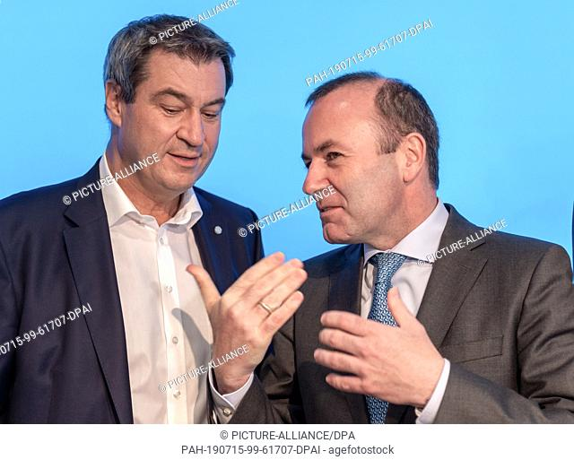 15 July 2019, Bavaria, Munich: Markus Söder (l), CSU Party Chairman and Prime Minister of Bavaria, and Manfred Weber, former top candidate of the CSU