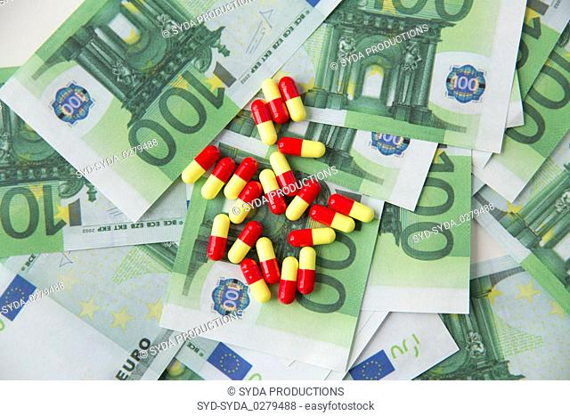 close up of pills or drugs and euro cash money