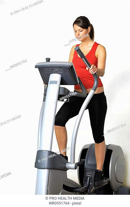 Young woman at a gym machine