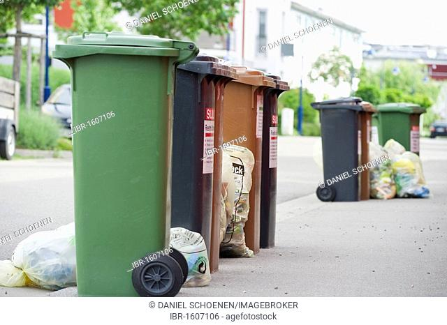 Garbage bins and yellow plastic bags, bags for the collection of recyclable packaging material in Germany