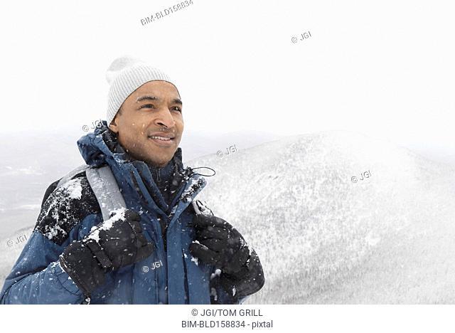 Black man hiking in snow