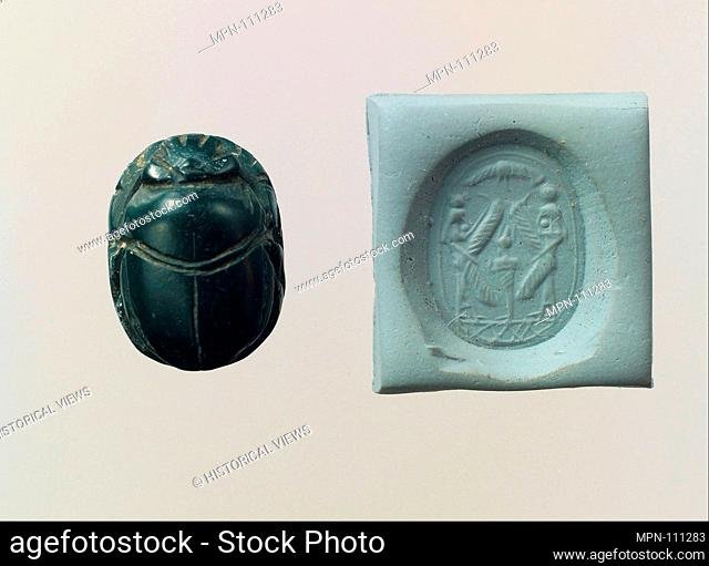 Scarab seal and modern impression: Osiris flanked by protective deities. Period: Iron Age; Date: ca. 6th-5th century B.C; Geography: Levant or Syria; Medium:...