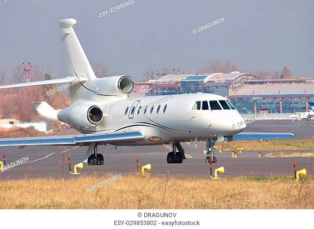 Business jet taxiing to the runway in the airport