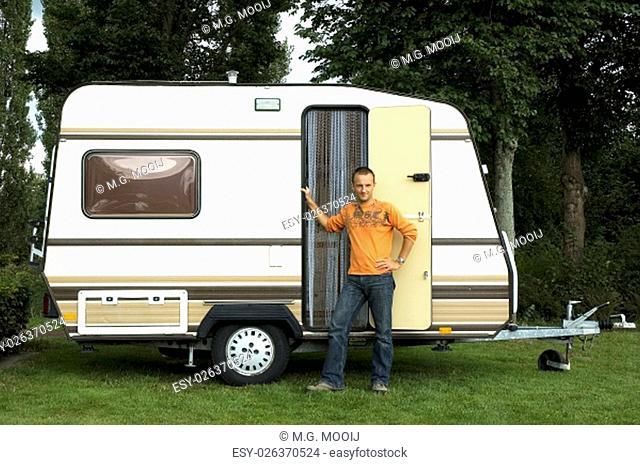 Man standing in front of his caravan