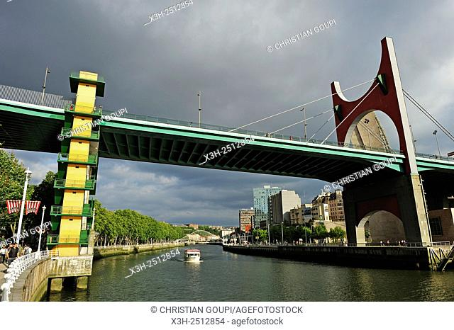 ''L'arc rouge'' The Red Arch by the French artist Daniel Buren on La Salve Bridge official name ''the Prince and Princess of Spain Bridge'' beside the...