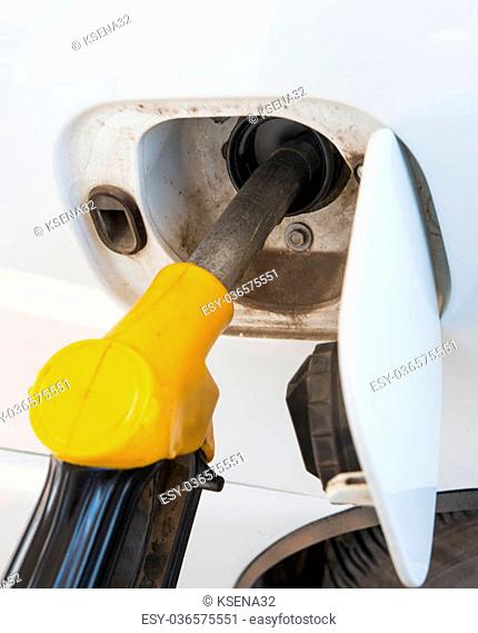 Close-up of arefilling the car with a gas