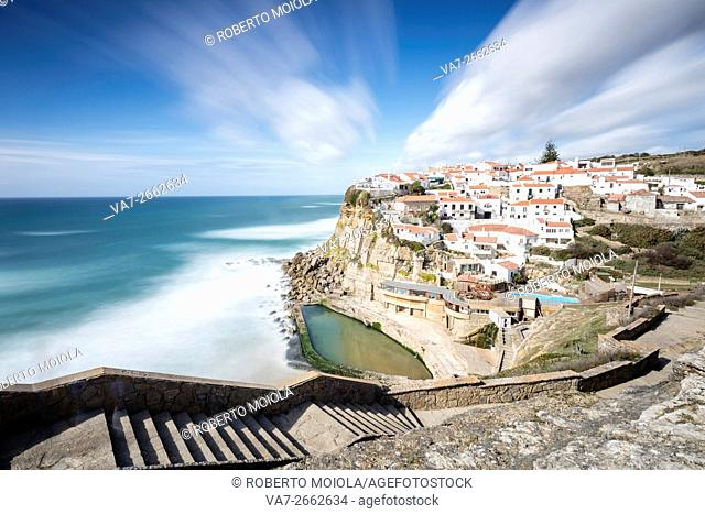 Top view of the perched village of Azenhas do Mar surrounded by the blue water of the Atlantic Ocean Sintra Portugal Europe