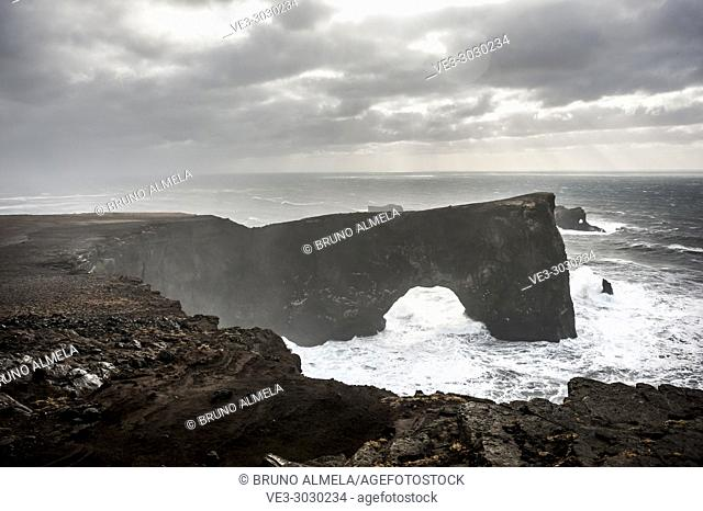 Arch and cliffs in Dyrhólaey (region of Suðurland, Iceland)