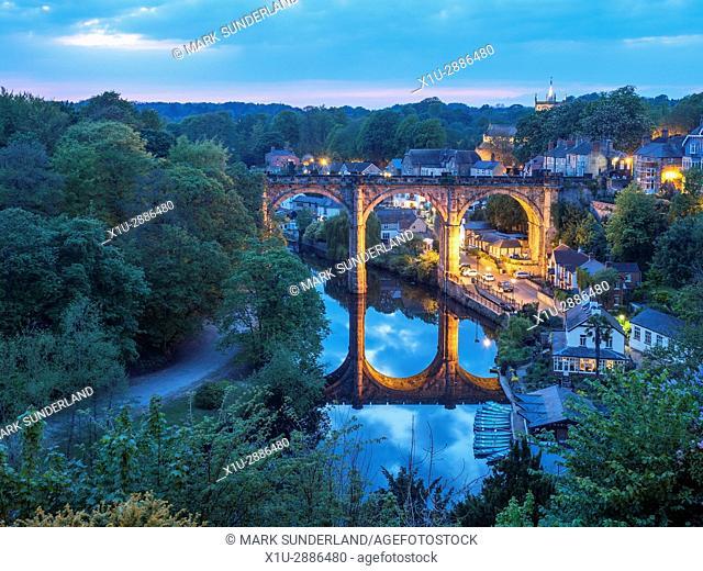 Railway Viaduct over the River Nidd Floodlit at Dusk, Knaresborough, North Yorkshire, England