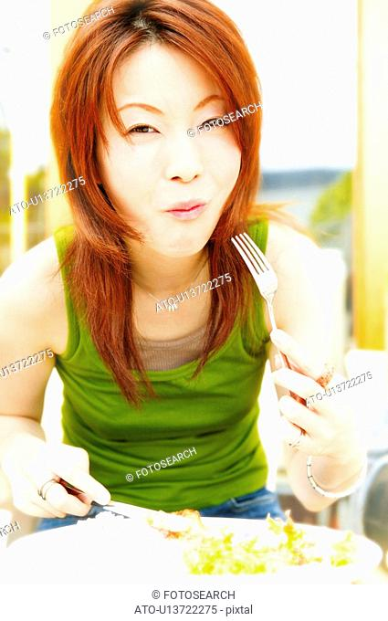 Young Adult Woman Eating a Food