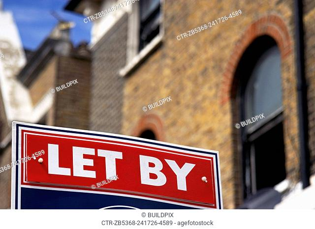 Estate Agent boards in front of houses, London